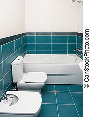 Vertical Shot of light bathtub in a bathroom.