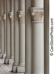 Vertical shot of multiple columns with carvings