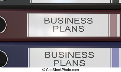 Vertical stack of multicolor office binders with Business plans tags different years