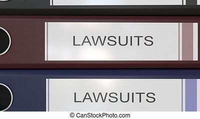 Vertical stack of multicolor office binders with Law suits...