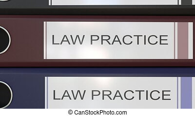 Vertical stack of multicolor office binders with Law practice tags