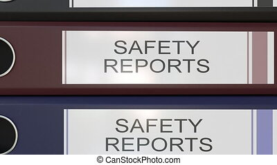 Vertical stack of multicolor office binders with Safety reports tags