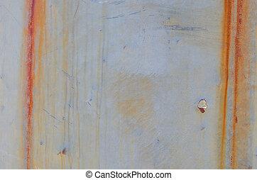 Vertical Streaks of Rust and Bullet Hole on Sheet Metal