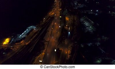 Vertical top down aerial view of night panorama of a big city