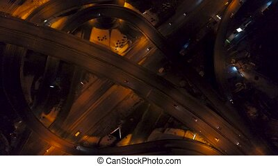 Vertical top down aerial view of traffic on freeway...