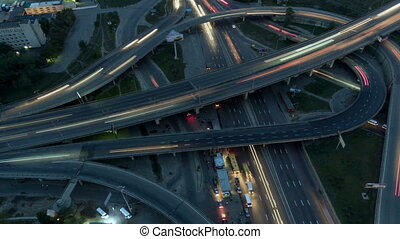 Vertical top down aerial view of traffic on freeway...