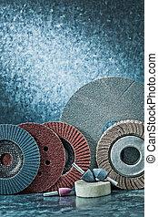 vertical version set of abrasive tools on metalic background