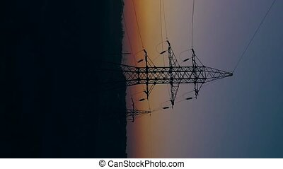 Vertical video. View from the height of power line...