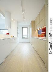 Vertical view of bright kitchen
