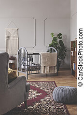 Vertical view of mid century baby room concept in grey vintage interior with green and white accents, real photo with copy space