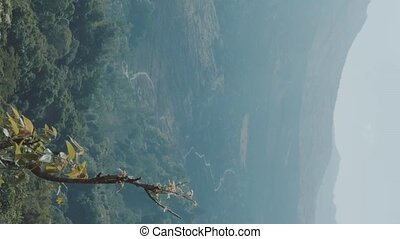 Vertical view of mountains landscape and sky in summer day...