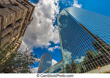 Vertical view of skyscrapers in downtown - The vertical view...