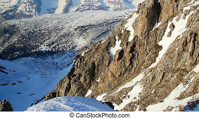 Vertical view of snowy mountain ridge with glacier on top, Alps
