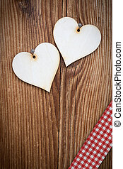 vertical wooden plank with two lovely hearts and checked ribbon