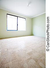 Green walled empty room with window and cork flooring..
