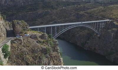 Vertigo effect with road and iron bridge over river - Pino...