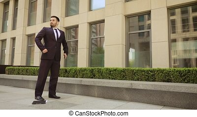 Very angry businessman walks down the street with a tablet...
