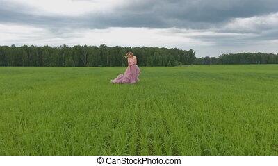 Very attractive women. girl in wedding dress walking. Slow motion.