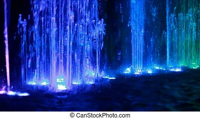 fountains with different illumination in circus of dancing fountains