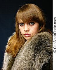 very beautiful girl in a fur coat