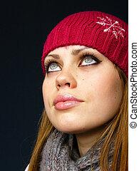very beautiful girl in a red cap