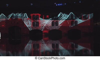 Very beautiful night laser show on the facade of the house. Beautiful laser and musical fountain show. 3D videomapping. Strasbourg, France.