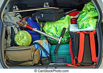 very car with the trunk full of luggage ready for the departure of family holidays