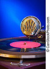 very close up view on gramophone on blue background