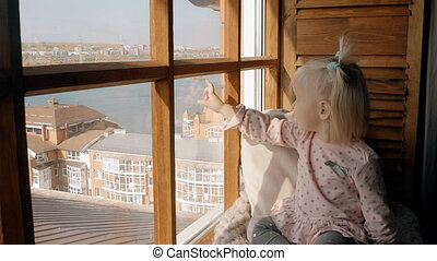 Very cute little girl look in window and smile so happily....