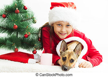 very cute little girl with a dog dressed in Christmas costumes