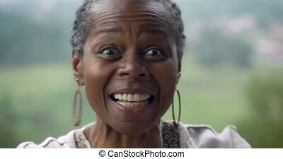 Very excited happy attractive African American woman in her...