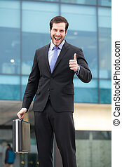 very happy businessman showing ok sign