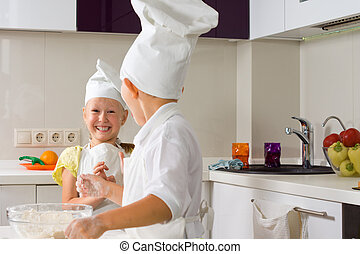 Very Happy Little Chefs Baking in Kitchen