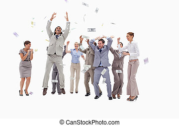Very happy people with money falling from the sky against...
