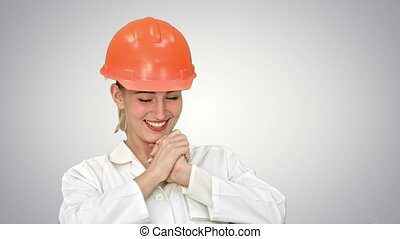 Very happy woman in orange helmet winning and celebrating her successful win on white background.