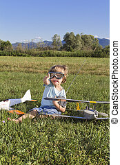 Very happy young boy with RC plane