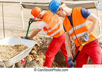 Very hard work - Construction workers and their very hard...