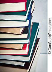 Very high stack of books on a table - Closeup of a Very high...