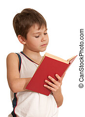 A boy is reading very interesting book; isolated on the white background