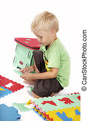 Children at play with color foam toys in studio enjoying their moments of games.