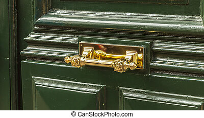 very nice brass door handle on a residential building