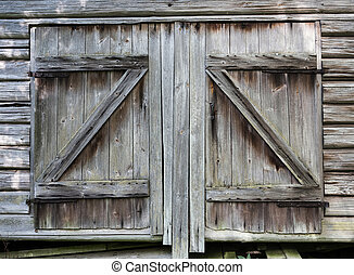very old barn doors on old shed in finland
