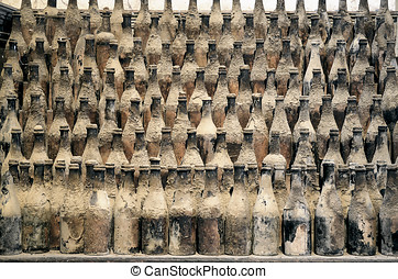 Very old bottles - Very old and dusty bottles stacked in...