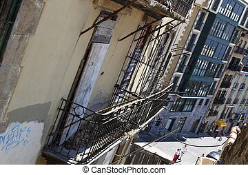 very old facade with wrought iron balconies in San Sebastian, Spain