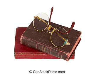 Very old glasses and a red book isolated