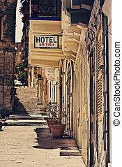 Very old run down hotel sign in Valetta, Malta.
