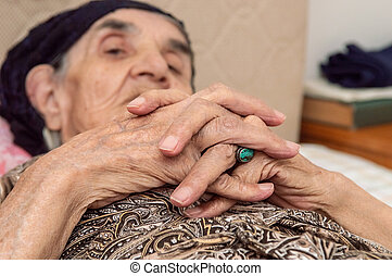Very old senior woman hands, wrinkled skin, aging process - ...