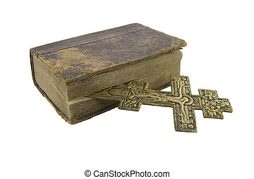 Very old vintage bible and big church cross near to it isolated over white background