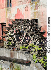 very old wheel of an ancient water mill