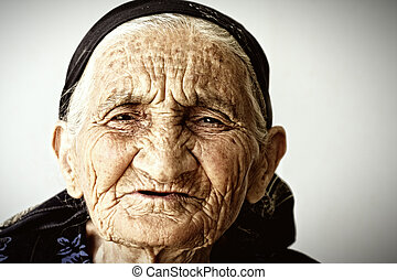 Very old woman face covere with wrinkles closeup photo